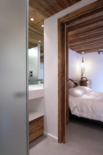 Chalet-A-montagne-Meribel-JMV-Resort-chambre-lit-intérieur bois