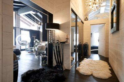 Appartement-Les-Airelles-montagne-Val-D'Isere-JMV-Resort-salon-couloir-tapis