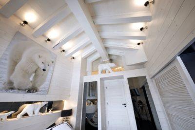 Appartement-Les-Airelles-montagne-Val-D'Isere-JMV-Resort-sculpture-ours-tableau