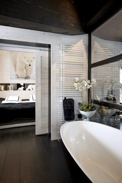 Appartement-Les-Airelles-montagne-Val-D'Isere-JMV-Resort- chambre-lit-salle de bain