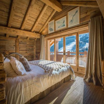 Chalet-SHL-montagne-Meribel-JMV-Resort-chambre- lit-bois
