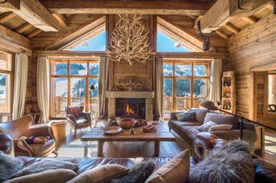 Chalet-SHL-montagne-Meribel-JMV-Resort-intérieur-salon-sculpture-bois-cheminé