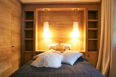 Chalet-Tiki-montagne-Meribel-JMV-Resort-chambre-lit-bois