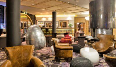 Hôtel-Koh-I-Nor-montagne-Val-Thorens-JMV-Resort-accueil-hall-fauteuil-cuir