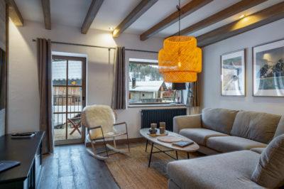 Chalet- Victoire Mijane - Méribel - salon - intérieur vue sur l'extérieur neige