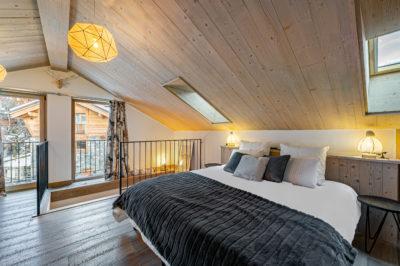 Chalet- Victoire Mijane - Méribel - chambre - lit -bois - JMV Resort